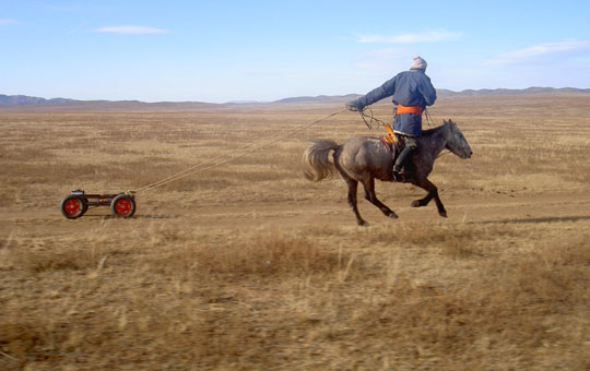 Mongolian Charges a Discarded Car Battery
